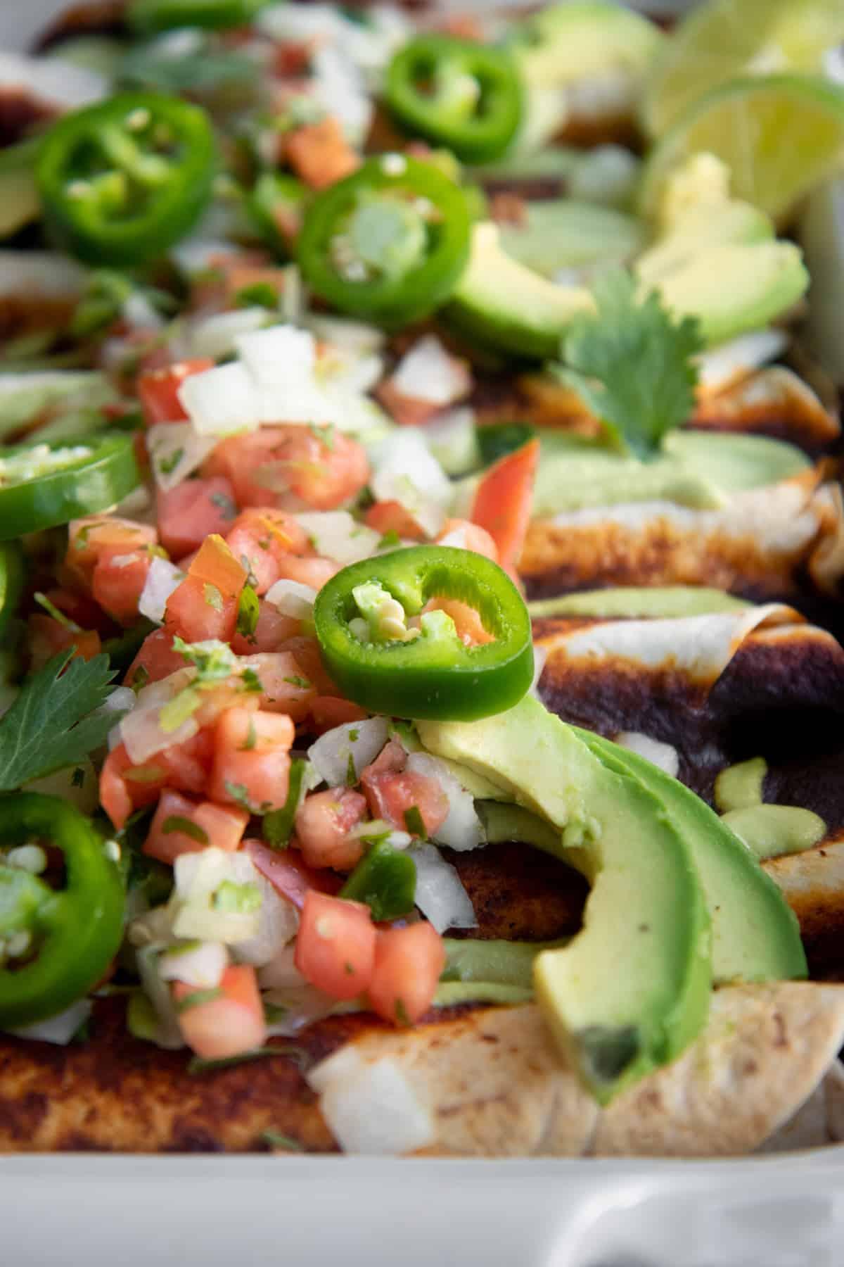 Close up of Pumpkin and Black Bean Vegan Enchiladas