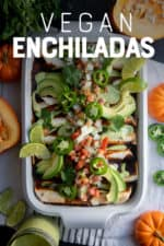 "White casserole dish filled with Pumpkin and Black Bean Vegan Enchiladas. A text overlay reads ""Vegan Enchiladas."""