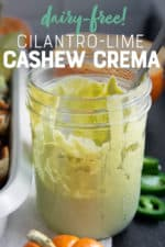 """Glass jar filled with pale green sauce. A text overlay reads """"Dairy-Free Cilantro-Lime Cashew Crema."""""""
