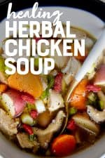 """A spoon with a white handle sits in a white bowl full of Instant Pot herbal chicken soup. A text overlay reads """"Healing Herbal Chicken Soup."""""""