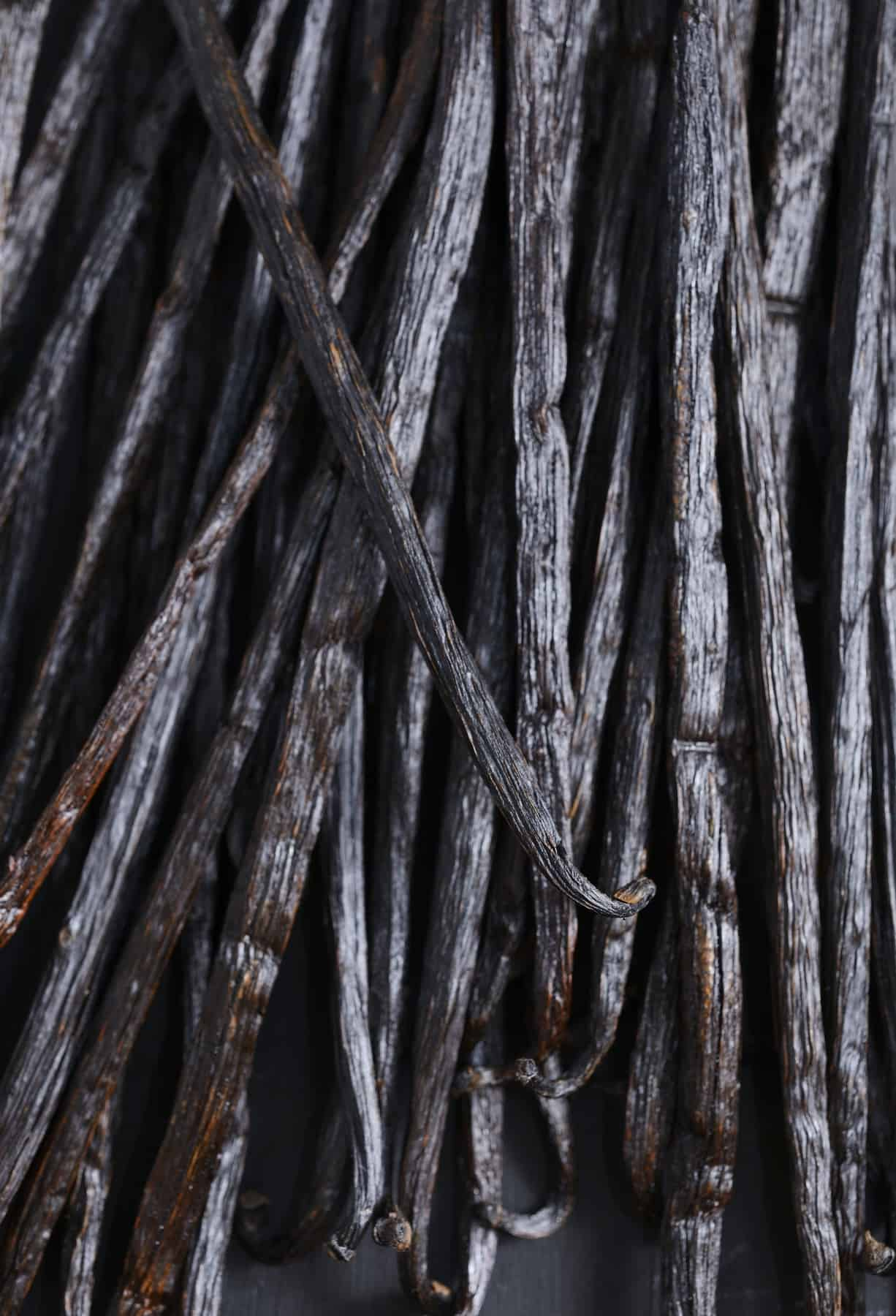 Close up of a stack of vanilla beans.
