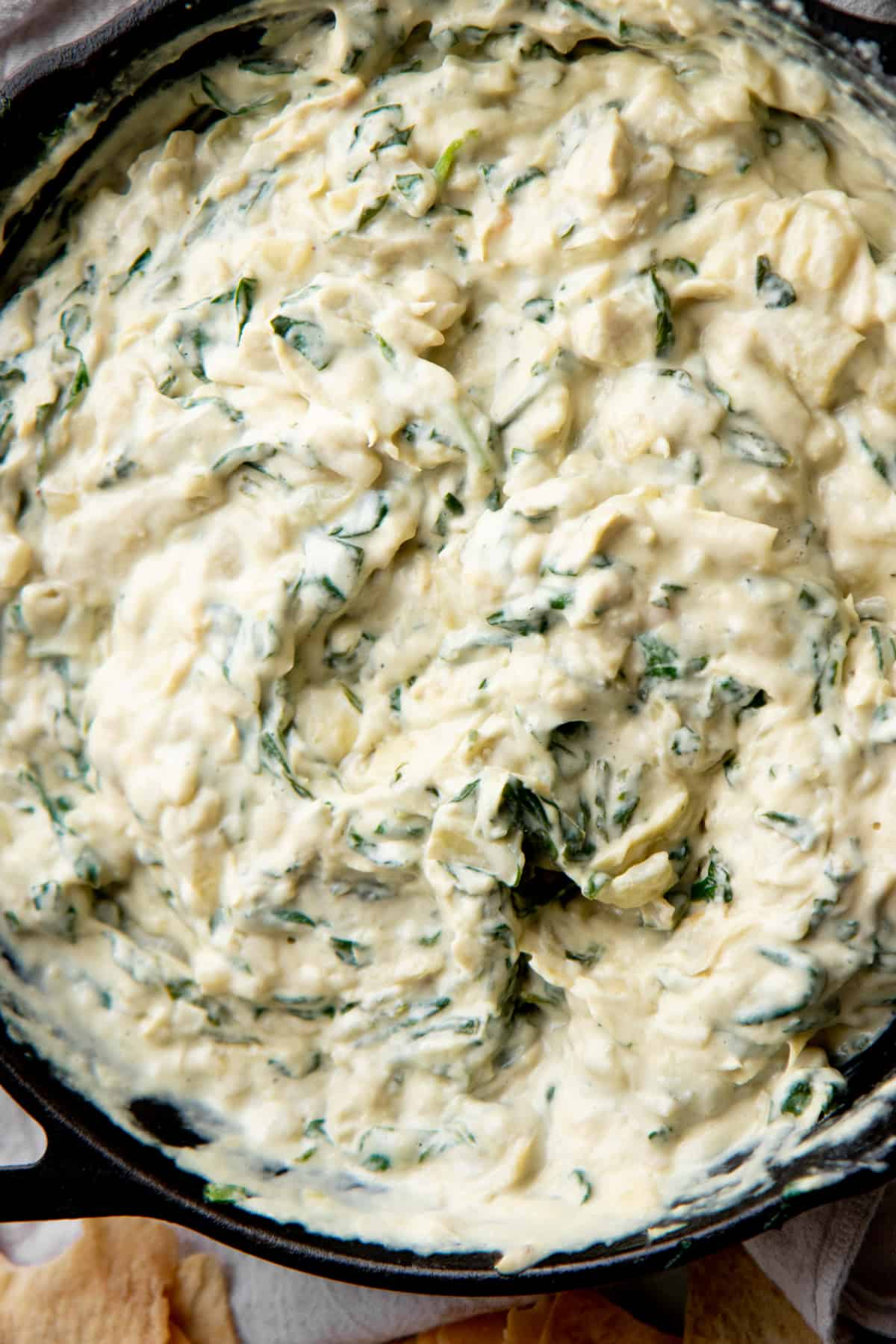 Close up of vegan spinach artichoke dip.
