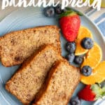 "Three slices of almond flour banana bread on a blue plate with mixed fruit, next to a cup of coffee. A text overlay reads ""Paleo Banana Bread."""