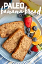 """Three slices of almond flour banana bread on a blue plate with mixed fruit, next to a cup of coffee. A text overlay reads """"Paleo Banana Bread."""""""