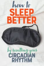 "A black sleep mask sits on white bedding. A text overlay reads ""how to Sleep Better by Resetting Your Circadian Rhythm."""