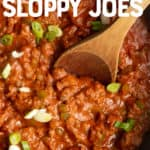 "A wooden spoon stirs filling for Sloppy Joes in a cast iron skillet. A text overlay reads ""No Sugar Added Sloppy Joes. Paleo & Whole30-Friendly."""