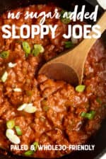 """A wooden spoon stirs filling for Sloppy Joes in a cast iron skillet. A text overlay reads """"No Sugar Added Sloppy Joes. Paleo & Whole30-Friendly."""""""