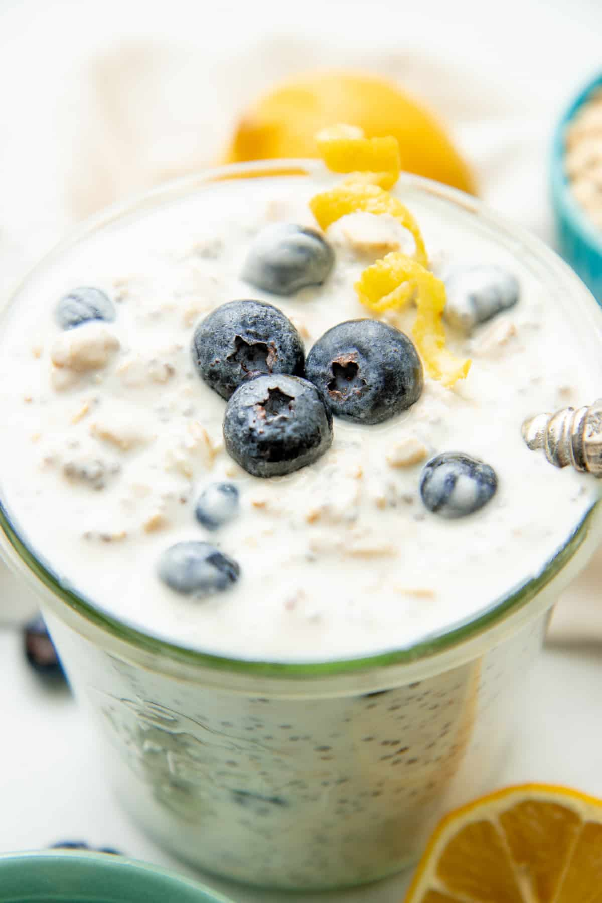 Overnight oats are topped with blueberries and a twist of lemon.