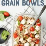 """A glass dish is arranged with ingredients for a caprese grain bowl. A cup of dressing rests in the upper left corner, and additional ingredients surround the container. A text overlay reads """"Meal Prep Chicken Caprese Grain Bowls."""""""