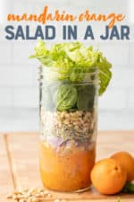 "Components for a mandarin salad layered in a mason jar - dressing, mandarin slices, onions, sprouts, pine nuts, and greens. Additional ingredients surround the jar. A text overlay reads ""Mandarin Orange Salad in a Jar."""