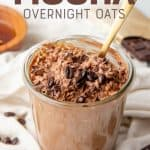 """A gold spoon sits in a jar full of mocha overnight oats. A text overlay reads """"Mocha Overnight Oats."""""""