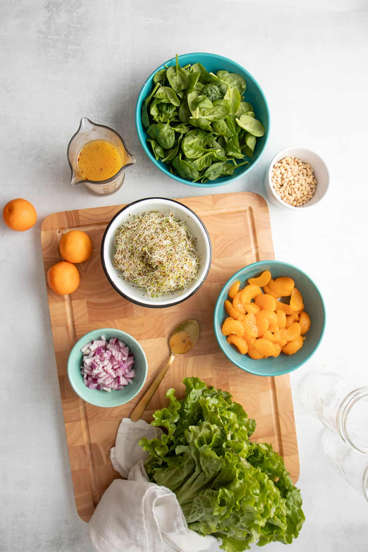 Ingredients for a sunshine mandarin salad in individual bowls.