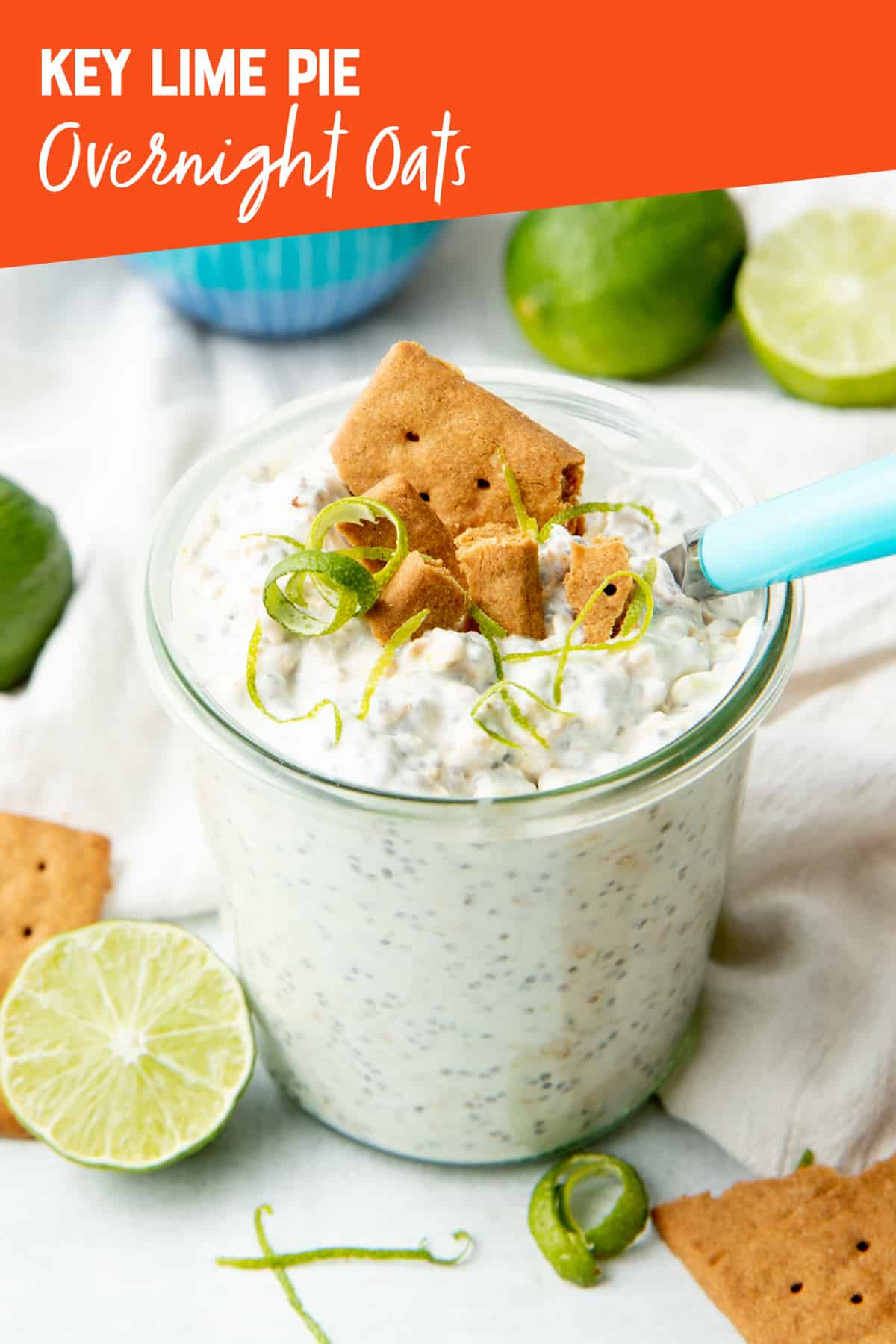 """A small glass jar is filled with overnight oats and topped with graham cracker and lime twists. Text overlay reads, """"Key lime pie overnight oats."""""""