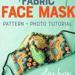 "The finished face mask sits on a green background. A text overlay reads ""Super Easy Fabric Face Mask. Pattern + Photo Tutorial. Plus How to Donate Them!"""