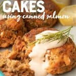 """A half eaten salmon patty sits on a plate. Lemons sit in the background. A text overlay reads, """"salmon cakes using canned salmon"""""""