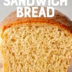 """A loaf of sandwich bread sits cut in half. A text overlay reads """"easy homemade sandwich bread"""""""