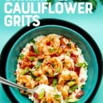 """An overhead shot of a bowl of Paleo Shrimp and Grits. A text overlay reads """"Paleo/Whole30 Shrimp and Cauliflower Grits."""""""