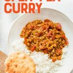 """A bowl of Curry sits with a biscuit off to the side. A text overlay reads, """"Vegan Split Pea Curry""""."""