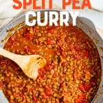"""A pot full of curry ingredients is stirred with a wooden spoon. A text overlay reads, """"Vegan Split Pea Curry""""."""