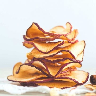 A stack of dried apple slices on a white background.